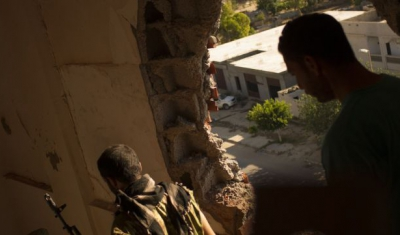 Libya, Fighters are seen in a house during an attack against militants.
