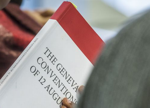 Student of the Executive Master in International Law in Armed Conflict with the book the Geneva Conventions